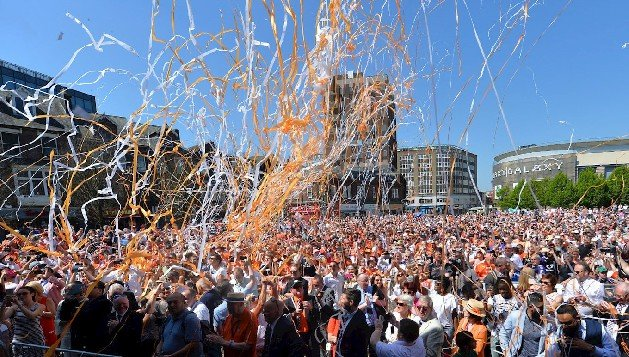 Orange and white streamers fill the air